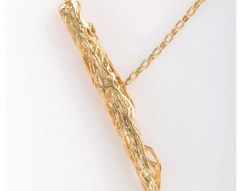 Gold  Branch  pendant  from the sabrawear collection  .