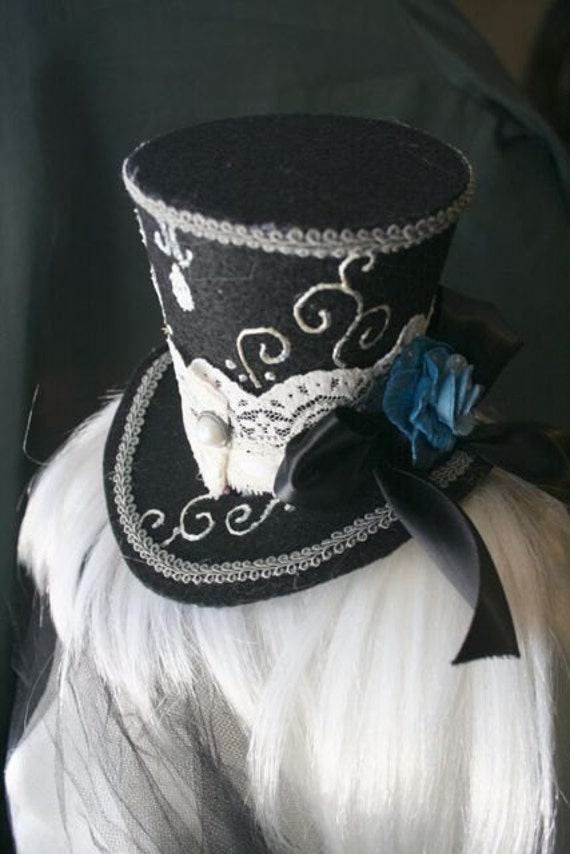 Elegant Black and Silver Mini Top Hat with Blue Rose