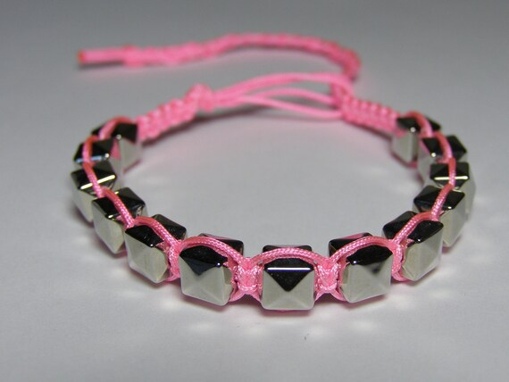 """Pink braclet with silvery """"studs"""""""