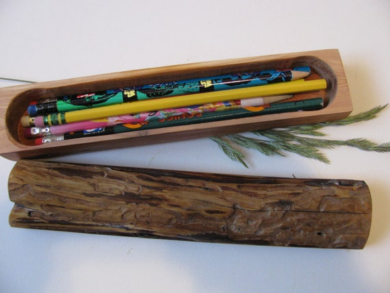 Log pencil box made from one length of dead standing juniper wood.