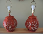 Pair of cinnamon colored GLASS Lamps with flower design.