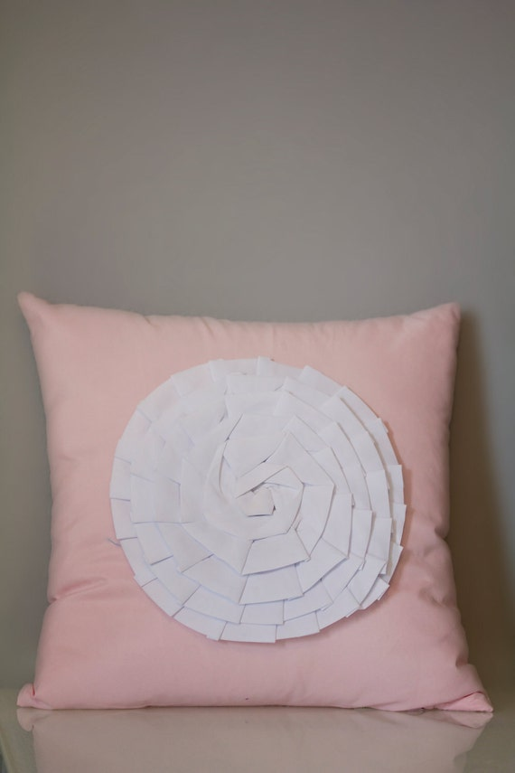 Pink cotton throw pillow with flower