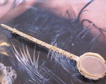 Musical instrument golden brooch