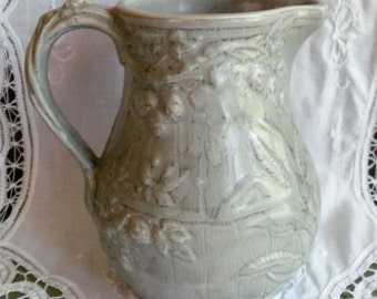 Sage Pitcher with floral relief pattern