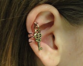 Wire Ear Cuff with a dangling key or feather
