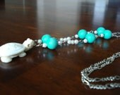 White turtle necklace with turquoise accent beads