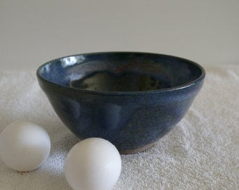 Stoneware bowl with blue and red glaze