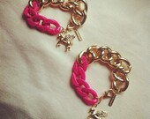 chunky pink and  gold chain bracelet with unicorn charm