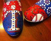 Custom hand painted canvas shoes.