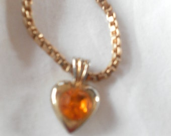 Vintage gold code necklace with gold glass centre