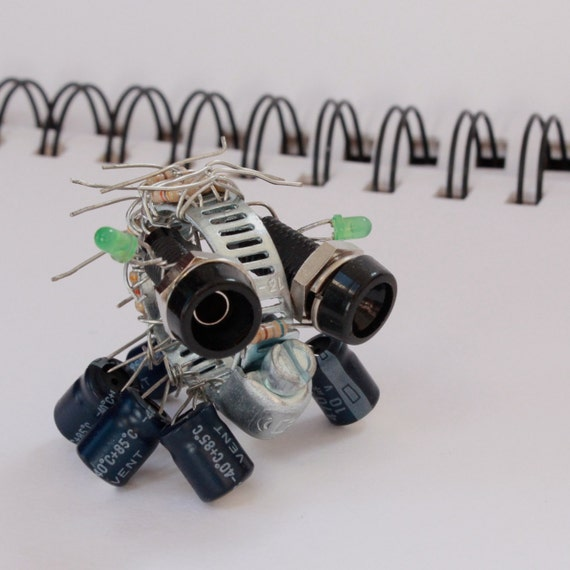 Small electronic component insect creature with resistors, capacitors and L.E.Ds. warhammer