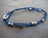 Silver-Plated Beads on Blue Cotton Cord Bracelet