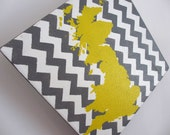 Yellow UK Silhouette with Grey and White Chevron Background