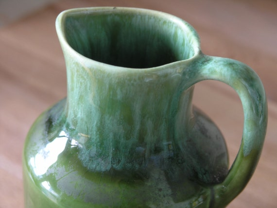 Small and green pottery syrup jar. Tuque Rouge. Quebec.