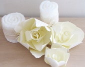 set of three white paper flowers for decorations