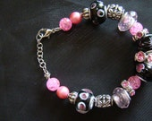 Pink, black and silver beaded bracelet