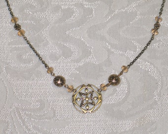Antiqued brass charm and crystal necklace