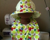 Keep Baby's head shaded from the sun and cloths drool free with this custom made bib/hat combo