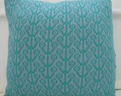 Knitted cushion 'Flowering Stems' in blue/green and emerald