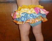 pink, blue, yellow, and orange ruffled diaper cover skirt size 6-12 month