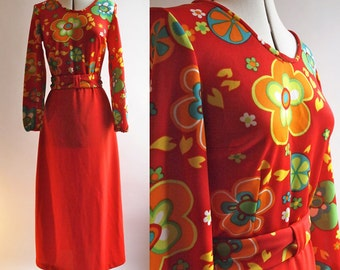1960's long crimped polyester red dress with bright floral and citrus patterned top and matching sash belt, long sleeved, size 10