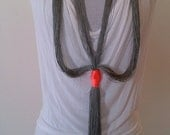 Yarn necklace, silky grey and neon orange knot, free shipping