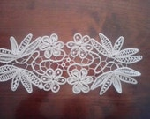 Rectangular doily with 4 flowers.