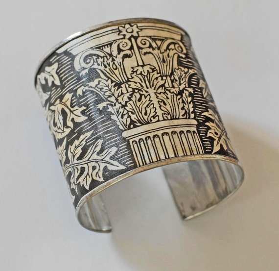 Bracelet cuff handmade out of recycled tin-metal and motif from vintage botanical book: Acanthus and Roman pillar