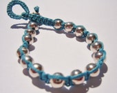 Silver plated Wrap Bracelet on Turquoise Waxed Linen