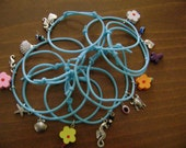 Bracelet for women blue rubber 10 pieces with metal charms and colorful beads.Perfect for gift.