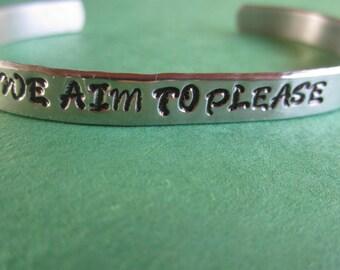 "We Aim to Please."" Bracelet"