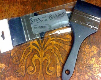 3 inch wide stencil shaper. This rubber squeegee like tool on a paint brush handle is great for use with stencils and even for painting.