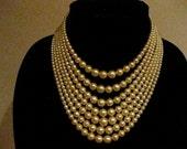 Vintage Seven Strand Golden Faux Pearl Necklace