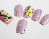 White flower on pink background. Nail enhancement, press on nails.