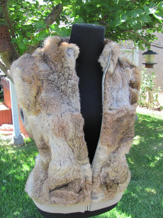 Sleevless sweater vest with rabbit fur front and collar.  Size Large.
