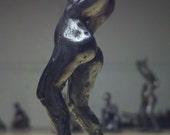 Bronze sculpture of dancing bronze figure
