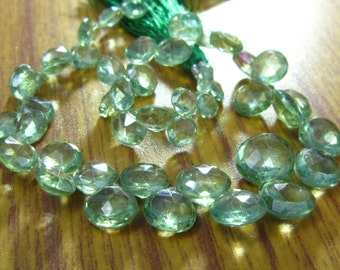 """AAA Rare Green Apatite faceted Heart Briolette- 7"""" Strand -Stones measure -6-10mm"""
