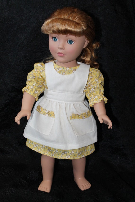 18 in Doll Dress and Pinafore, Betty Outfit in Yellow with Muslin Pinafore.