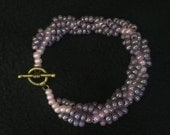Pink and Purple Beaded Bracelet with Bronze/Brown Toggle