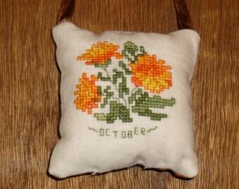 October Calendula cross stitch pocket pillow