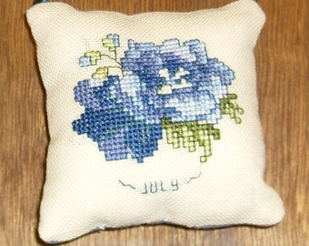July Larkspur cross stitch pocket pillow
