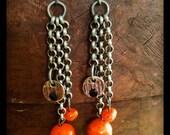 Gunmetal chain and Orange beads