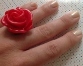 34mm red resin rose on a black resin ring base. The size is approximately a 7 1/2