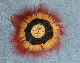 Handmade Red and Gold Feather Rosette Pin with Steampunk Clock Face