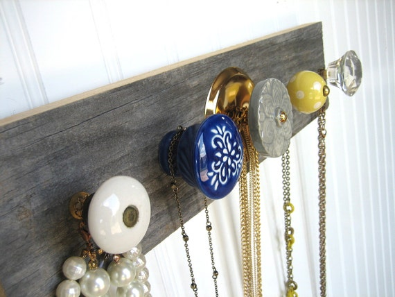 Jewelry Organizer with Blue, Yellow, and Grey Knobs