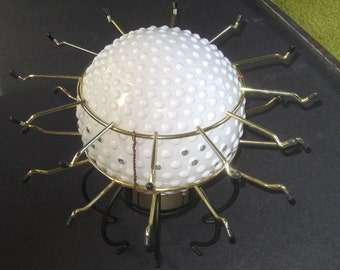Handmade upcycled glass globe UFO lamp for beautiful mood lighting.