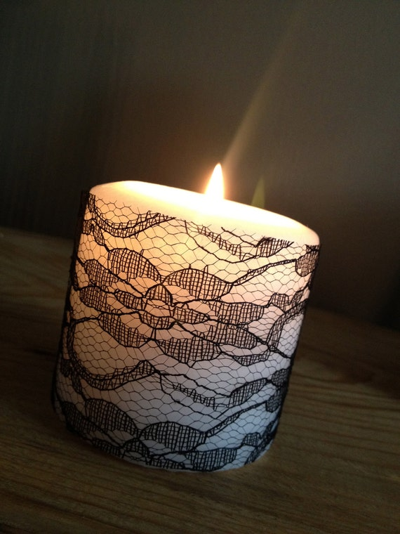 White Candles With Lace and Old Book Pages
