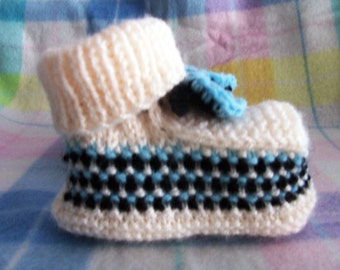 Knitted antique white baby booties with blue and black patterning and crocheted ties - baby shower gift - newborn gift