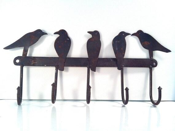 birds on a wire hook