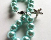 Teal Glass Pearl Beads with a Silver Starfish Charm Stretch Bracelet